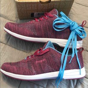 Women's walking shoe. New. Size 11